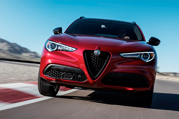 A front view of the 2019 Alfa Romeo Stelvio being driven on a track.