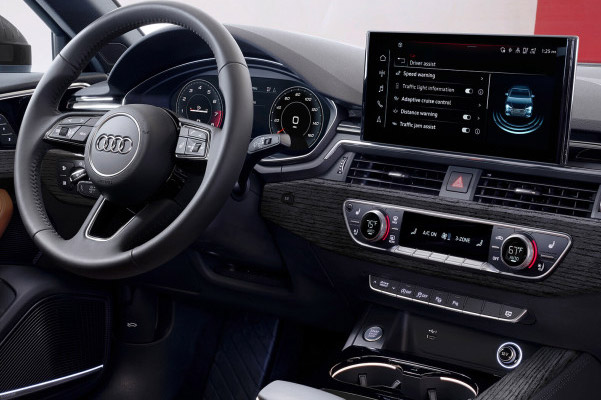 Audi A4 Interior showcasing the dashboard, steering wheel, digital screen and brown leather interior