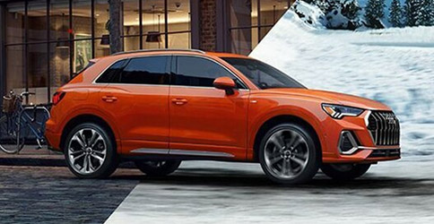 orange Audi Q3 crossing fall into winter season