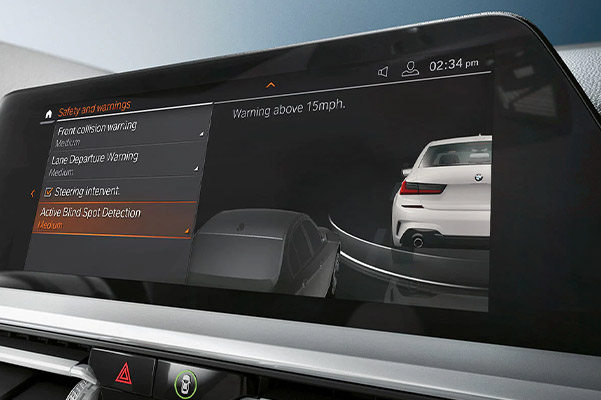 BMw Digital screen showcasing	Active Blind Spot Detection feature