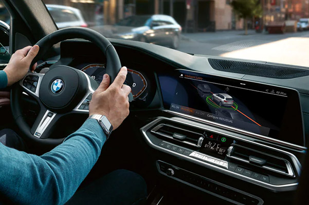 BMw Digital screen showcasing Frontal Collision Warning with City Collision Mitigation feature
