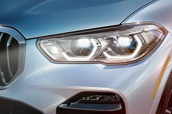 close up of Automatic high beams on a BMW suv