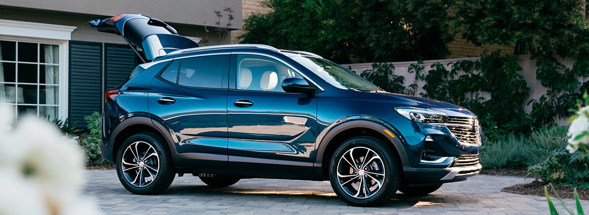 Image of a 2020 Buick Encore GX in a driveway with the tailgate open