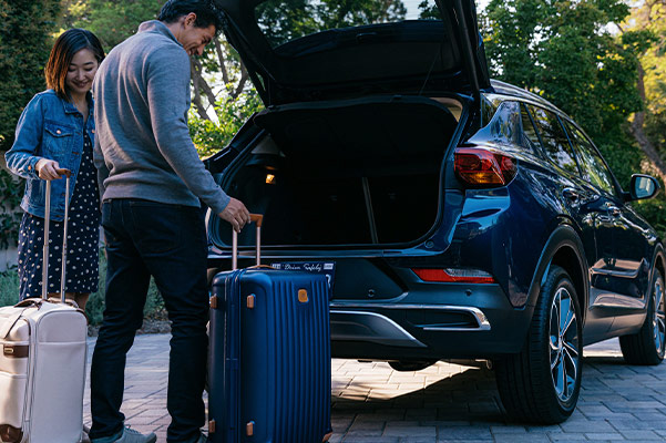 Loading up back of Buick Encore GX with suitcases