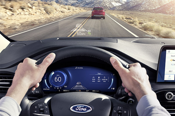 interior pilot view of Ford Escape crossover showcasing heads up diplay in the windshield