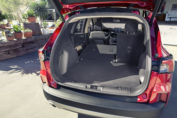 rear view of Ford Escape crossover with the back door open showcasing space capability