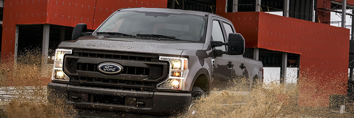 2020 Ford Super Duty driving through mud