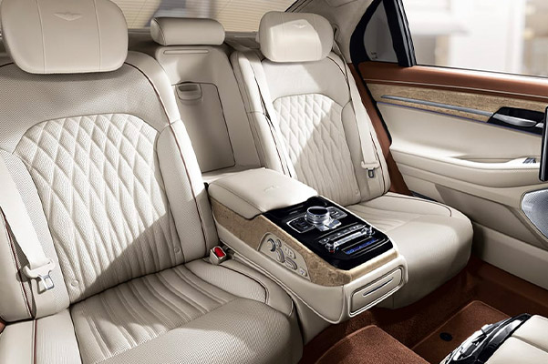 interior view of Genesis G90 showcasing white leather interior seats