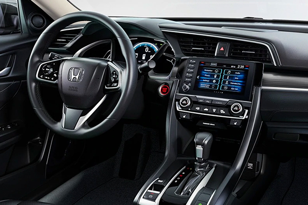 interior view of honda civic vehicle showcasing the digital screen and driver's dashboard