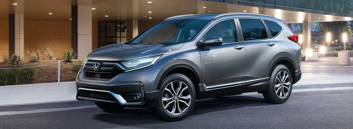 Front driver-side view of the 2020 Honda CR-V Touring in Modern Steel Metallic.