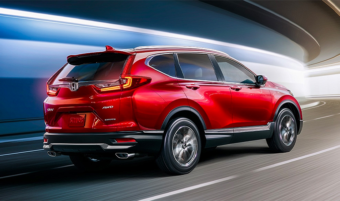 Rear passenger-side view of the 2020 Honda CR-V Touring in Radiant Red Metallic.