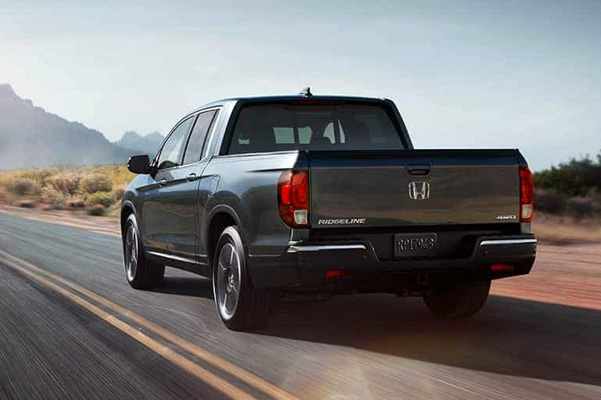 2020 Honda Ridgeline grey driving away