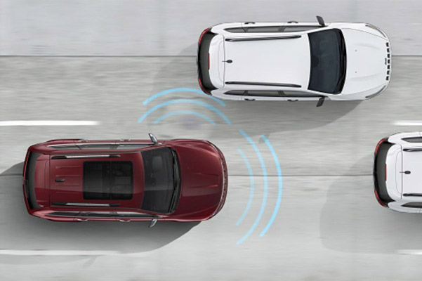 Aerial view of a 2020 Jeep Grand Cherokee activating Collision warning feature