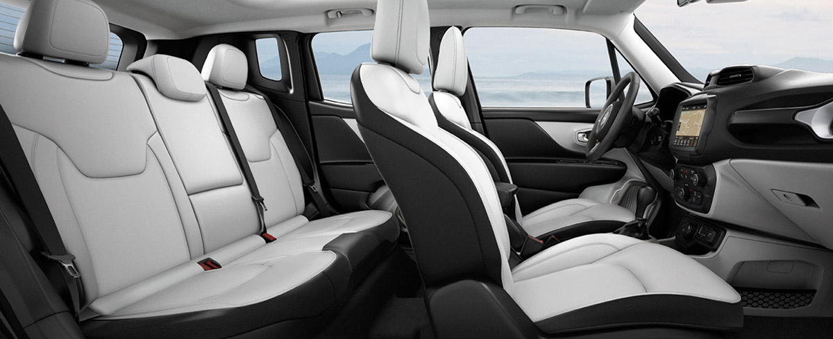 interior side view of the Jeep renegade suv showcasing white leather interior seats