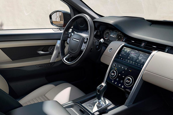 interior view of Land Rover Discovery sport suv showcasing the front dashboard with digital screen