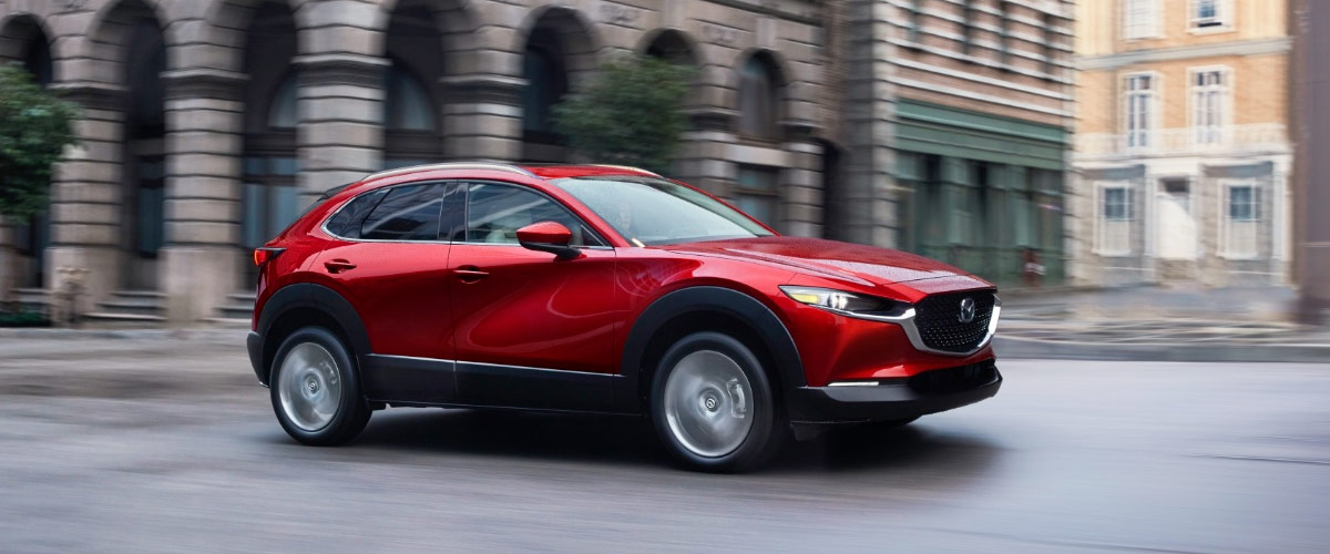 CX-30 on city street side view in red