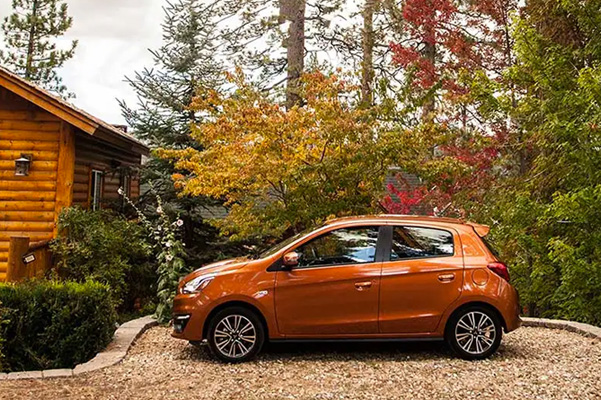 Mirage in Sunrise Orange Metallic, side profile under autumn leaves