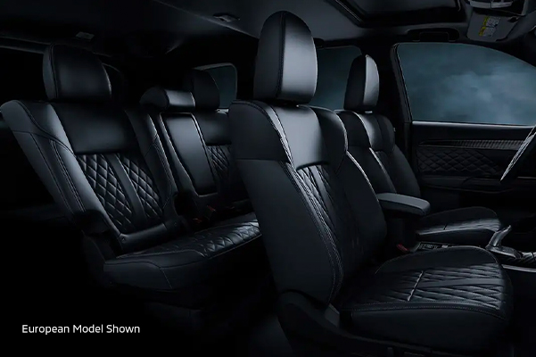 Interior side view of the legroom from the front and back seats inside the 2020 Mitsubishi Outlander PHEV.