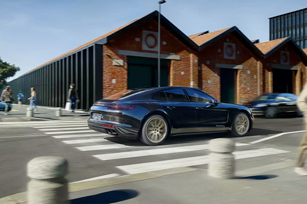2020 Porsche Panamera driving over crosswalk