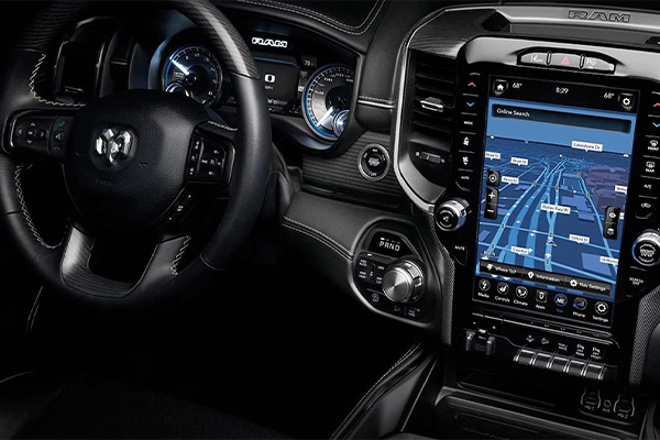 The 12-inch touchscreen on the Uconnect 12.0 displaying a navigation route, available on the 2020 Ram 1500.
