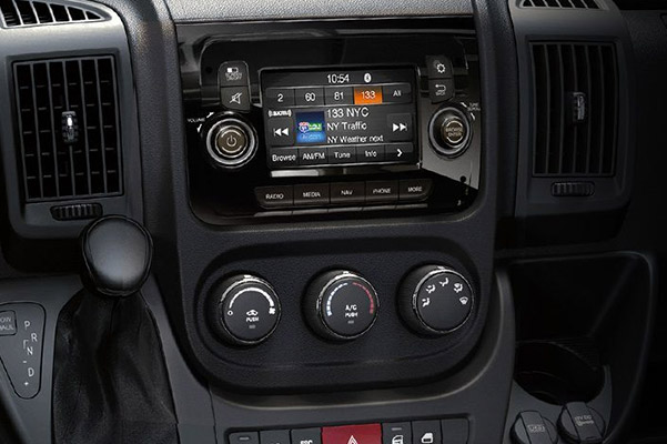 The steering wheel, instrument panel and entertainment system on the 2020 Ram ProMaster.