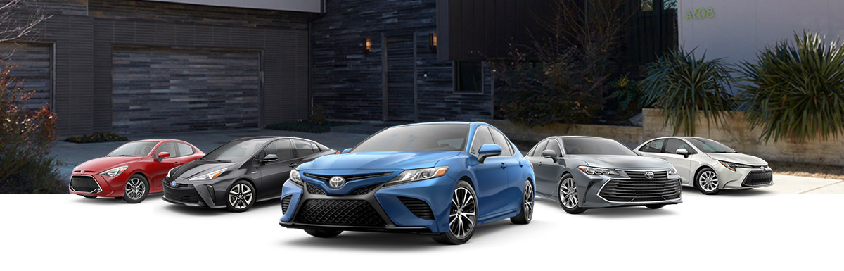 2020 Toyota Sedan Lineup in front of a driveway