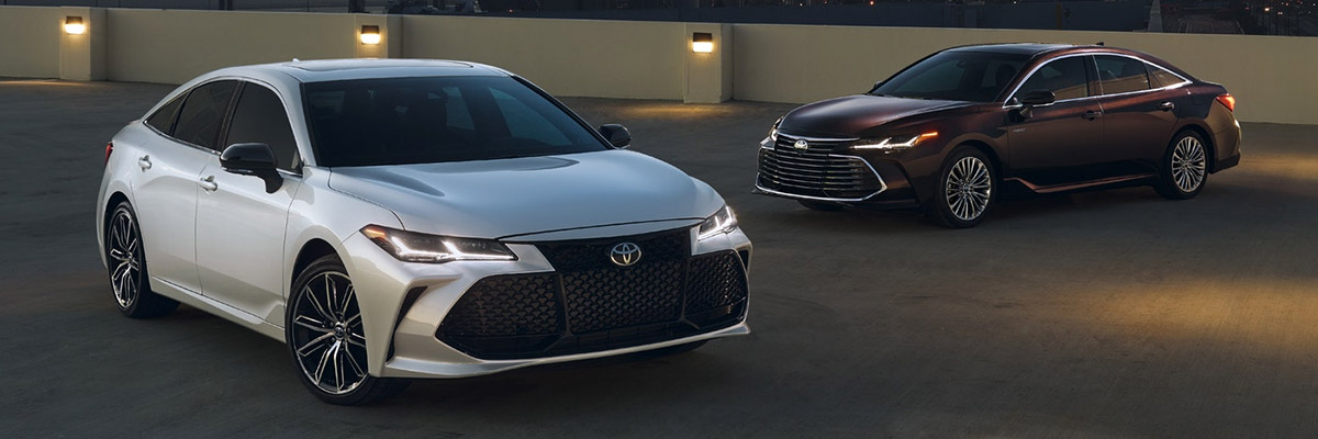 Two 2020 Toyota Avalons parked in a parking lot