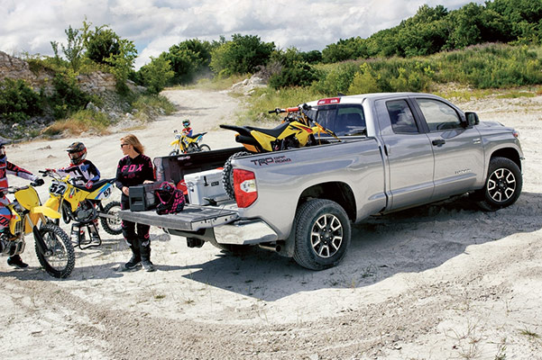 2020 Toyota Tundra silver color with dirt bikes on the truck bed