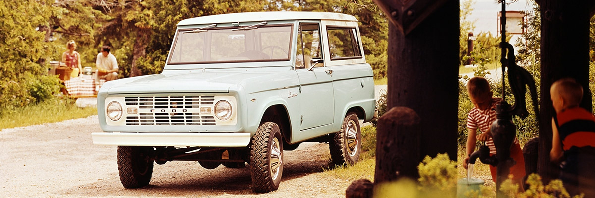 1968 Ford Bronco Sport Wagon in Sky View Blue with a Wimbledon White metal roof.