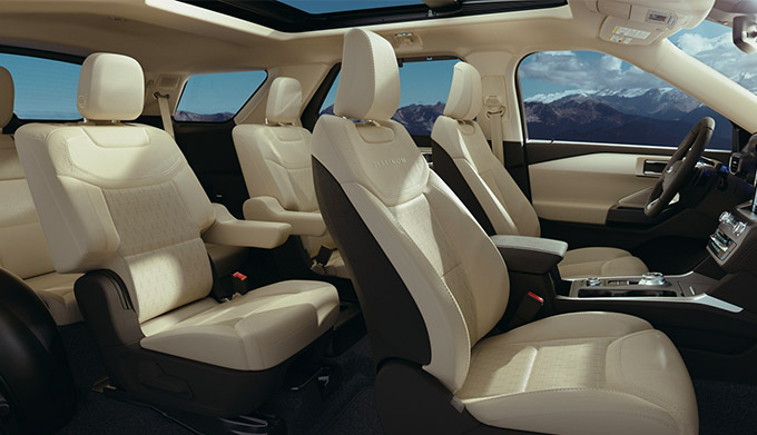 interior view of ford explorer showcasing three row white leather seats