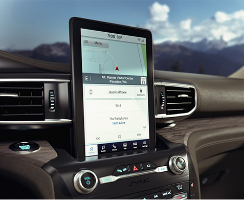 interior view of ford explorer showcasing vertical digital screen on the driver's dashboard