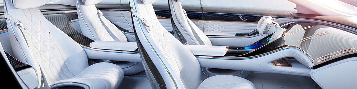 interior view of Mercedes Benz EQS electric sedan featuring white leather seats