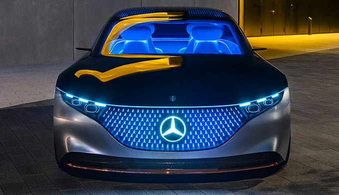frontal profile of Mercedes Benz EQS showcasing digital front grill and headlights
