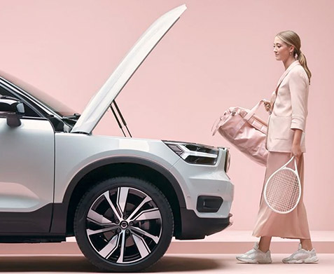The XC40 Recharge  Woman approaching to XC40 Full Electric with open hood