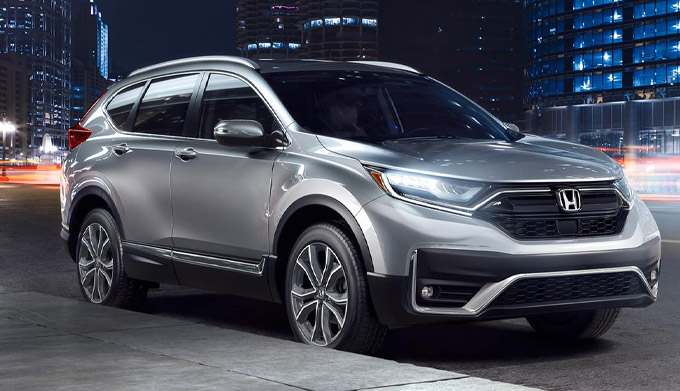 silver 2021 honda cr-v front view on the street