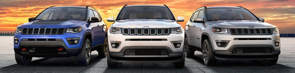 A head-on view of three 2021 Jeep Compass models, Trailhawk, Limited and High Altitude.