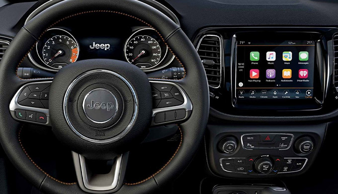 The steering wheel, instrument cluster, Uconnect touchscreen and center stack on the 2021 Jeep Compass.
