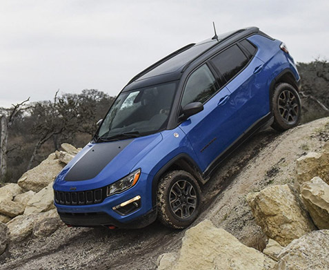 The 2021 Jeep Compass descending a steep, rocky hill.