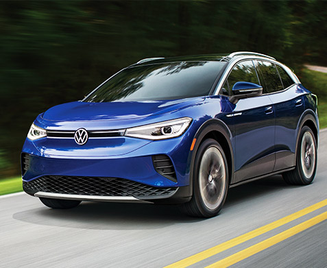 Front view of 2021 ID.4 EV in blue driving down road.