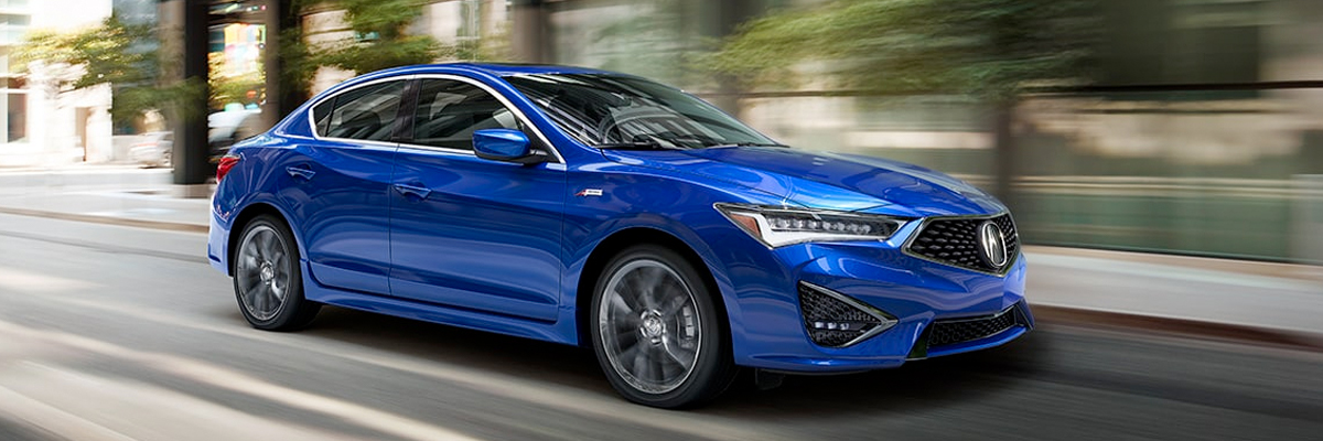 Blue ILX driving at high speed