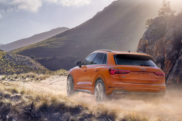2021 Audi Q3 driving up mountian on dirt road