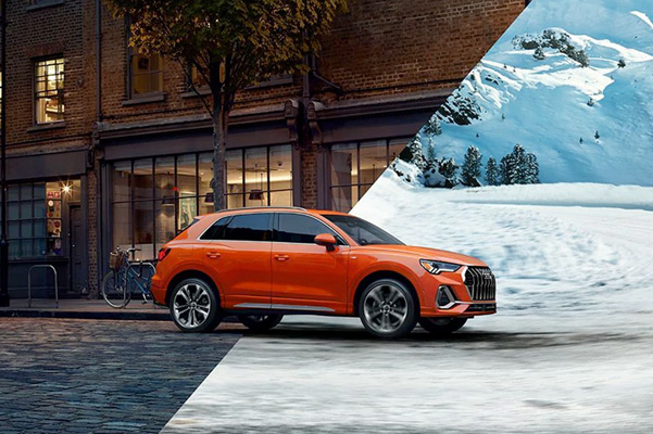 2021 Audi Q3 half in city hald in snow landscape