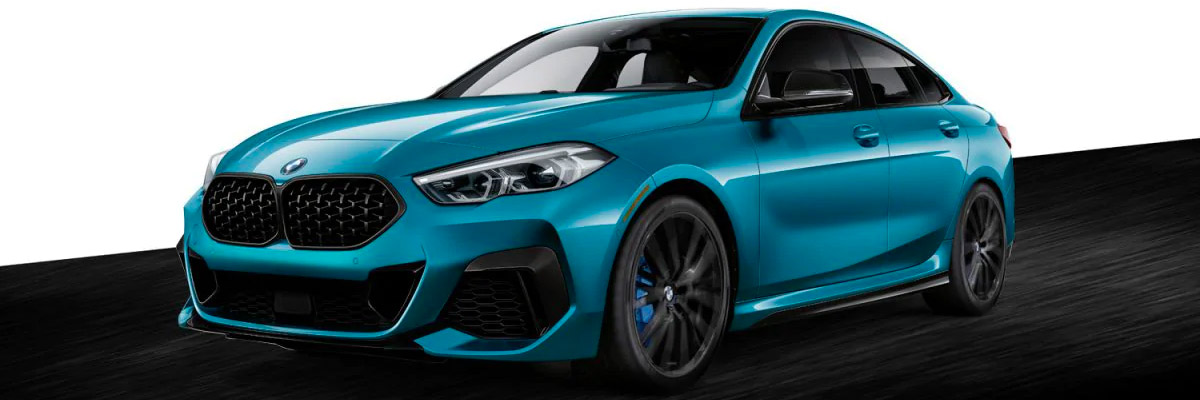 Front shot of the 2021 BMW 2 Series Gran Coupe with colorblock background