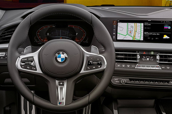 interior view of 2021 BMW 2 series showcasing driver dashboard and digital screen