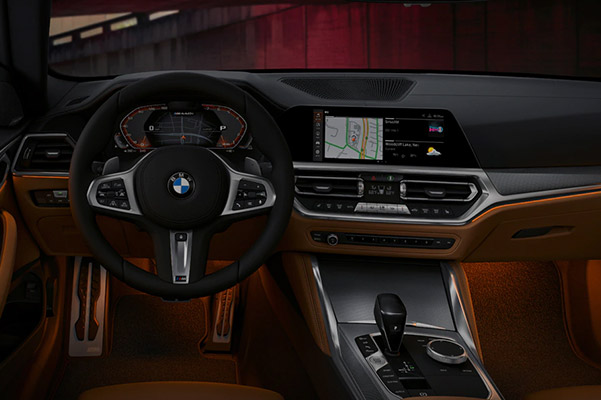 interior shot of BMW 4 series couple showcasing leather interior, front dashboard and digital screen