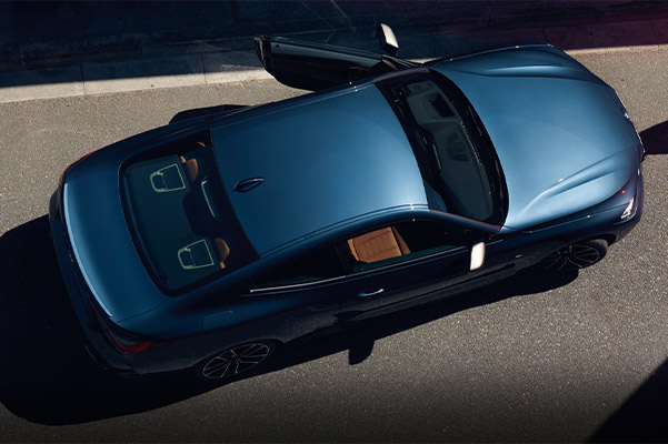 aerial view of BMW 4 series coupe showcasing vehicle with side doors open