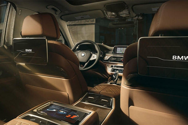 Interior shot of passenger seating in the BMW 7 Series Sedan with Rear Seat Entertainment system