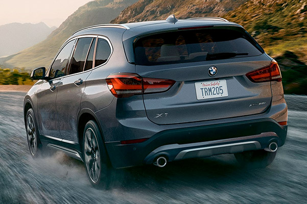 2021 BMW X1 driving through a mountain setting to illustrate the capabilities of the xDrive