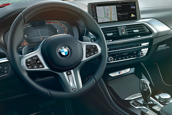 interior shot of BMW X4 Sav featuring driver dashboard and digitak screen