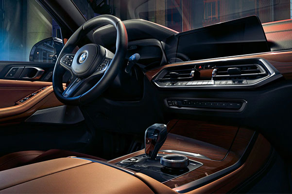 Interior close-up of BMW X5 available Glass Controls, heated front armrests, and premium leathers